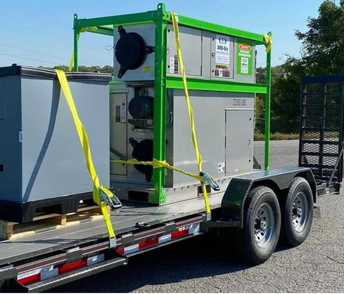 photo of commercial grade desiccant dehumidifier strapped to back of long bed truck.