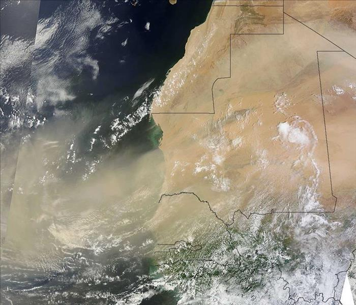Storm Damage African Dust Helps Prevent Tropical Storms from Forming